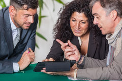 Couple with Financial Consultant Stock Image