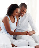 Couple finding out results of a pregnancy test. Afro-american couple finding out results of a pregnancy test in the bedroom stock photos