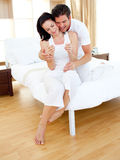 Couple finding out results of a pregnancy test. Cheerful couple finding out results of a pregnancy test in the bedroom stock photos