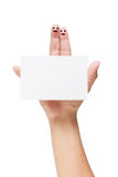 Couple of fingers with painted smiley holding note isolated on w. Couple of fingers with painted smiley holding note isolated on the white background stock images