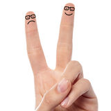 Couple of fingers with sketched smiley Stock Image