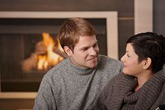 Couple by fireplace Royalty Free Stock Photography