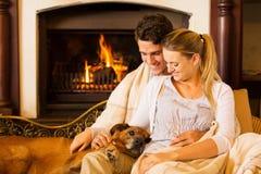 Couple fireplace dog Royalty Free Stock Photography
