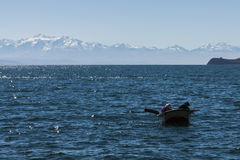 Couple of fishers in titicaca lake Stock Images
