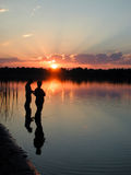Couple fishing. Two people evening fishing on the river in Ontario Stock Photography