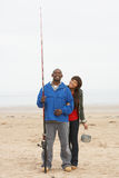 Couple Fishing On Beach Royalty Free Stock Photography
