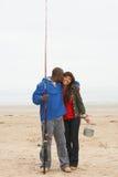 Couple Fishing On Beach Royalty Free Stock Image