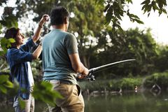 Couple fishing in the jungle Stock Image