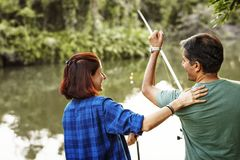 Couple fishing in the jungle. Together Stock Images