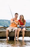 Couple fishing on pier Stock Photos
