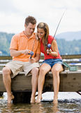 Couple fishing on pier Royalty Free Stock Photos
