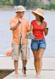 Couple fishing on pier Royalty Free Stock Images