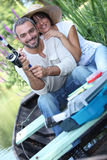 Couple fishing on the river Royalty Free Stock Photo