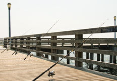 A couple of fishing rod. On a pir royalty free stock photo