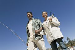 Couple on fishing trip, holding hand, smiling Royalty Free Stock Photography