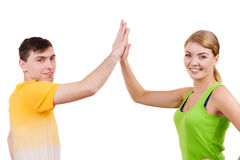 Couple fit friends joyful giving high five in celebration Stock Images