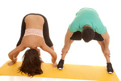Couple fitness both stretch bend over forward Royalty Free Stock Image