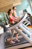 Couple in a fitness center doing a cardio excercises Royalty Free Stock Photo
