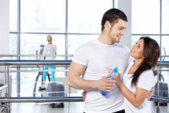Couple in fitness club. Happy embracing young couple in fitness club Royalty Free Stock Photo