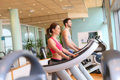 Couple in a fitness club excercising Stock Image