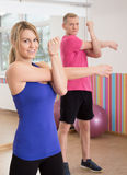 Couple in fitness club. Young attractive couple exercising in fitness club Stock Photo