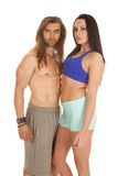 Couple fitness together both looking Royalty Free Stock Images