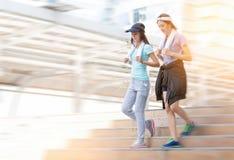 Couple fitness women jogging in urban city stock photos