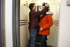 Couple in fitting-room. With winter jacket Royalty Free Stock Photos
