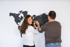 Couple is fixing the world map Stock Photo