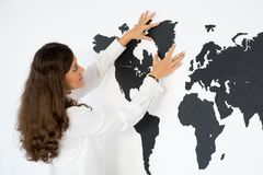 Couple is fixing the world map Royalty Free Stock Images