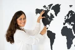 Couple is fixing the world map Stock Image