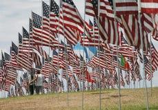 Couple among flags. Couple walking among flags on display at 9/11 memorial Stock Image