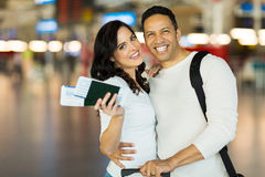 Couple flight tickets. Adorable couple with flight tickets and passports at airport stock photo
