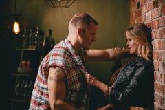 Couple flirting at bar Stock Photos