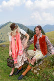 Couple flirting in the Bavarian costumes Stock Images