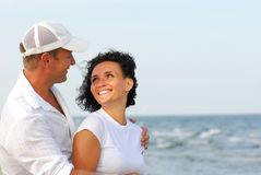 Couple flirting on beach Royalty Free Stock Photography