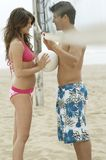 Couple Flirting on Beach under Volleyball Net Royalty Free Stock Photography