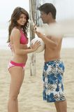 Couple Flirting on Beach with volleyball Royalty Free Stock Image
