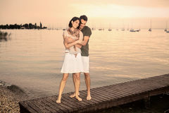 Couple flirting on the boardwalk at the lake Royalty Free Stock Photo