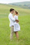 Couple flirting countryside Royalty Free Stock Images