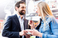 Couple flirting at date drinking coffee in cafe Royalty Free Stock Photo