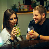 Couple flirting and drinks cocktails Stock Photo