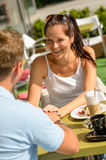 Couple flirting holding hands at cafe bar Stock Images