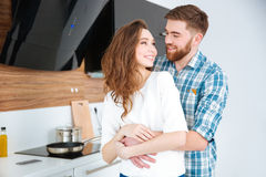 Couple flirting in the kitchen at home Royalty Free Stock Images