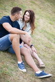 Couple flirting on lawn Royalty Free Stock Photography