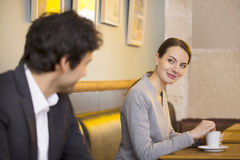 Couple Flirting Together In Bar Stock Photos