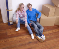 Couple on floor with boxes Stock Photo