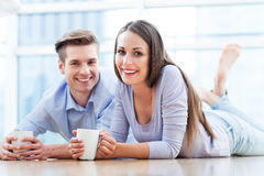 Couple on floor drinking coffee Stock Photo