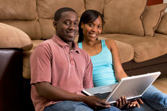 Couple On The Floor With A Laptop-Horizontal Royalty Free Stock Image