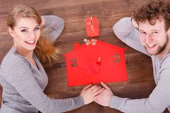 Couple on floor with symbols. Royalty Free Stock Photography
